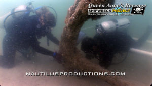 Underwater archaeologists Wendy Welsh (L) and Chris Southerly (R) of the North Carolina Underwater Archaeology Branch prepare to install an anode on the North anchor of the Queen Anne's Revenge shipwreck.